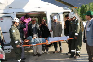 FOCUS Volunteers helping crtical patients in parts of GB, using AKDN heli.JPG